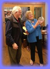 Rotary President Mike Crumpton presents Inner Wheel President Pam England with the much coveted trophy
